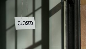 white closed hanging signage