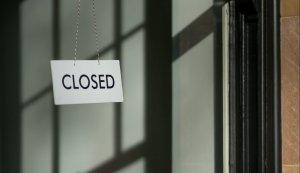 white closed hanging signage