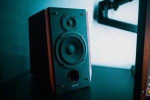 black and brown bookshelf speaker on black surface